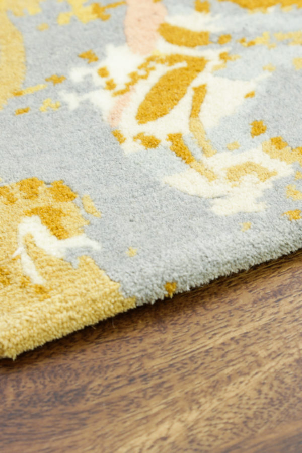 Yellow and grey rug on hardwood